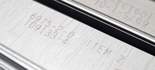 NeuroCheck Identifikation von geprägten Ziffern (Abbildung © designed by dannyburn - Fotolia)